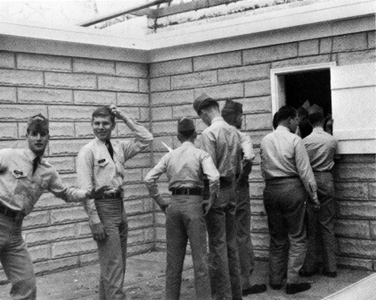 Cadets waiting in line to collect their dry cleaning circa 1970